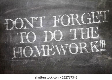 Don't Forget to Do The Homework written on blackboard