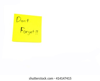 Don't forget in paper note  on white background with copy space