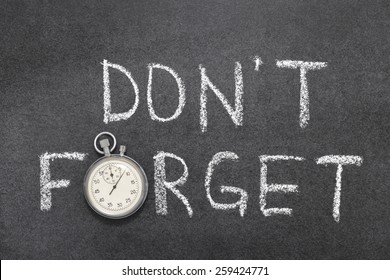 don`t forget phrase handwritten on chalkboard with vintage precise stopwatch used instead of O