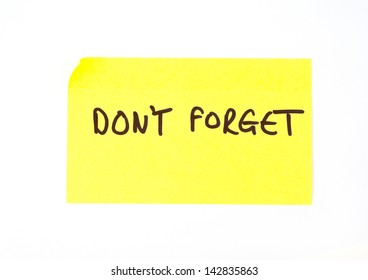 'Don't Forget' written on a yellow sticky note