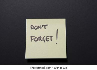 """""""don't forget"""" written in a ticket reminder sticker"""