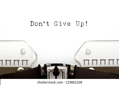 Don't Give Up printed on typewriter