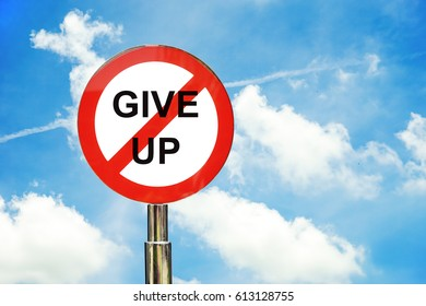don't give up sign post with white cloud and blue sky background
