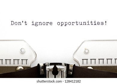 Don't Ignore Opportunities printed on an old typewriter.