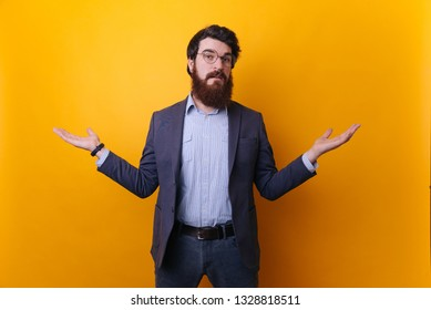 I don't know. Bearded man in formal doing don't know gesture. Human body language. Whatever attitude reaction