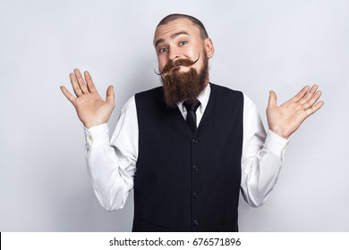 I Dont Know. Handsome businessman with beard and handlebar mustache looking at camera and confused. studio shot, on gray background.