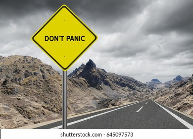 Dont panic highway sign on stormy sky background