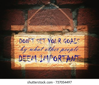 Don't set your goals by what other people deem important. Billboard, Background brick, Motivation, poster, quote, blurred image, illustration