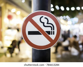 Don't smoke sign, No smoking sign in the market with a blurry background.