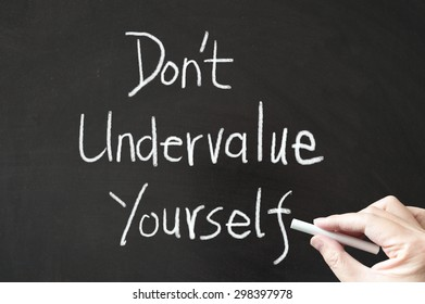 Don't undervalue yourself words written on the blackboard using chalk
