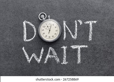 don`t wait phrase handwritten on chalkboard with vintage precise stopwatch used instead of O