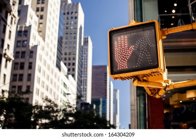 Don't walk New York traffic sign with illuminated and blurred background
