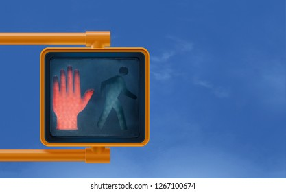 Don't  walk red hand stop street sign signal for  Urban street cross walk pedestrians with blue sky wispy clouds