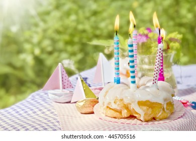 donut with birthday candles in the garden