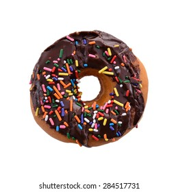 Donut with Chocolate Icing and Rainbow Sprinkles Above Isolated