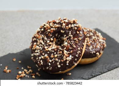 Donut with cocolate and chopped almonds