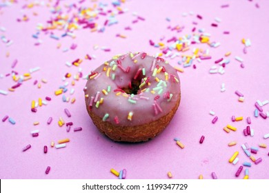 donut donuts sprinkles on doughnuts pink bright sugar strands background 100s and thousands decoration