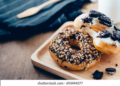 donut and milk on wooden table