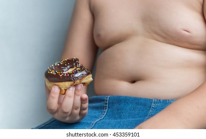 donut in obese fat boy, junk food can cause obesity.