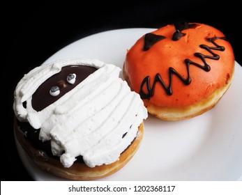 Donut on black background Halloween food