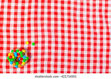donut on a red table cloth.