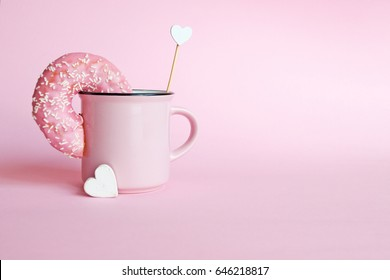 Donut in a pink coffee mug
