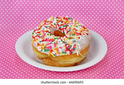 Donut with sprinkles on a plate