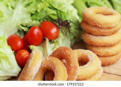 donut and sugar - fresh vegetable salad.