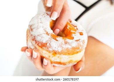 Donut in woman's hand, close up