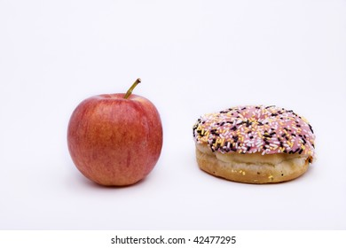 Donuts and apple isolated on white