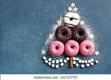 Donuts. Christmas tree from colorful donuts.