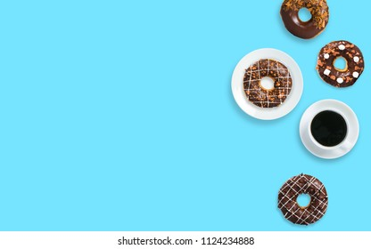 donuts and coffee on color background