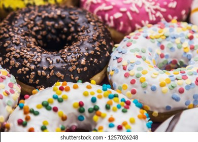 donuts covered with icing, chocolate, nuts with different fillings
