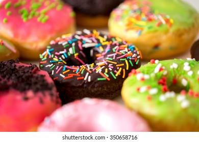 Donuts glazed with sprinkles