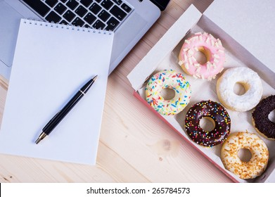 Donuts with notebook and pencil