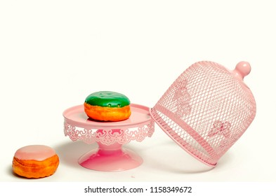 Donuts on white pink cake stand