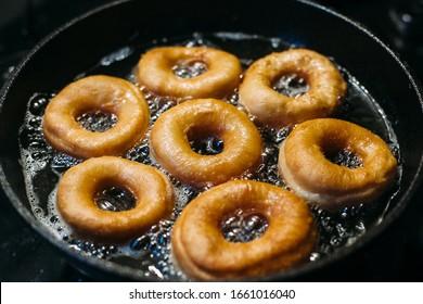 Donuts in a pan. Preparing donuts at home.