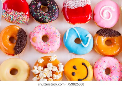 donuts pastry  - sweet and colorful donuts cakes in box, top view flat lay scene