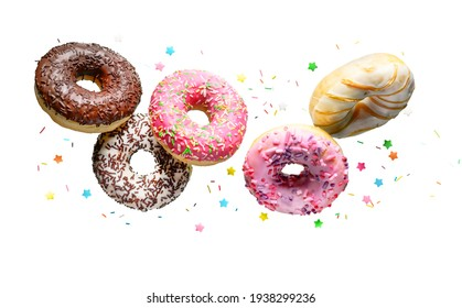 Donuts with sprinkles flying over white background.
