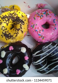 Donuts strawberry and chocolate.