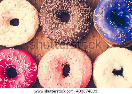 Donuts. Sweet icing sugar food. Dessert colorful snack. Glazed sprinkles. Treat from delicious pastry breakfast. Bakery cake. Doughnut with frosting. Baked unhealthy round.
