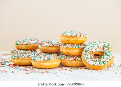 Donuts with white chocolate cream and sprinkles sugar on top - Unhealthy food style