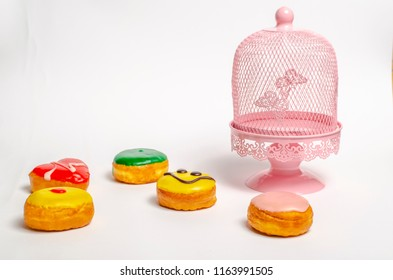 Donuts and white pink cake stand