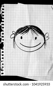 Doodle of a little girl on a sheet of paper