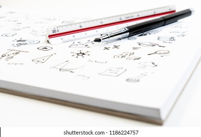 Doodle set of school related items, school equipment and learning tools on white notebook for background.