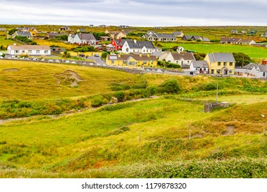 Doolin village with houses and farm fields, Clare, Ireland