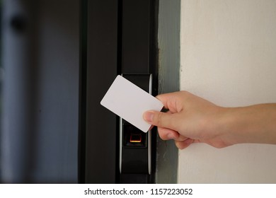 Door access control with a hand inserting key card to lock and unlock door.