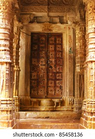 """The door of an ancient jainist temple in Jaisalmer, the magnificent """"Golden City"""" in the heart of Rajasthan (India), surrounded by the desert of Thar."""