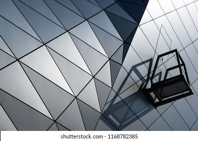 Door and balcony in a geometrical facade of of a modern building.