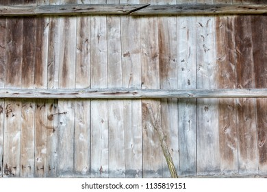 The door to the barn made of wooden boards
